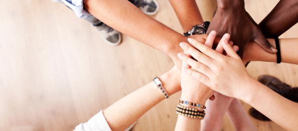 hands-in-teamwork_header